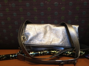 folded over - can be clutch or smaller cross body